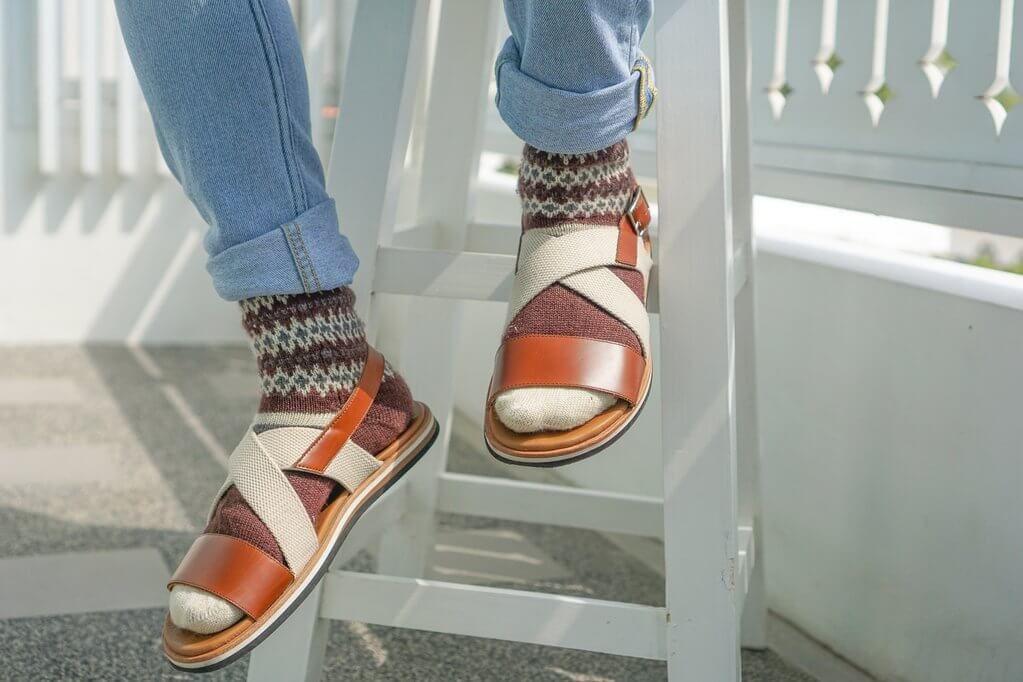 man wearing patterned socks with sandals